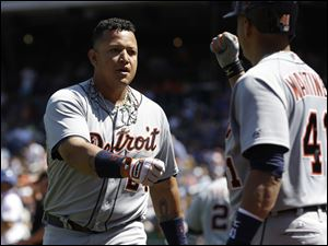 The Tigers' Miguel Cabrera, left, celebrates his two-run home run with teammate Victor Martinez during the first inning Sunday in New York. Cabrera's two-run drive was his 42nd long ball of the season and 10th in 19 games. He went 3 for 4 with a walk, raising his batting average to a major league-best .360, and finished the series 7 for 13 with two homers and five RBIs.