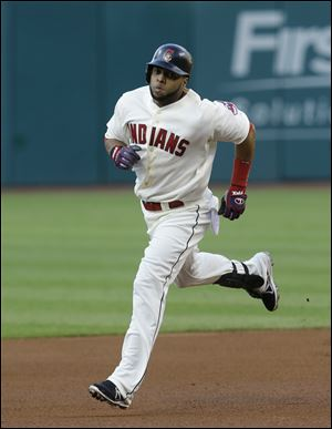 Cleveland's Carlos Santana runs the bases after hitting a two-run home run off Minnesota Twins starting pitcher Liam Hendriks in the first inning Saturday, in Cleveland.