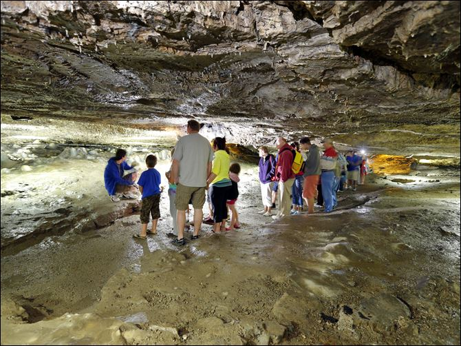 Perry's Cave in Put-In-Bay Tourists listen to stories inside of Perry's Cave in Put-in-Bay. It is believed that Oliver Hazard Perry and his men used the cave as a source for drinking water during the War of 1812.