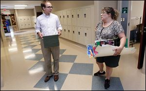 Bill Byrnes, science and social studies teacher, and Sharon Clark, English and language arts teacher, chat in a hallway of the new wing as they prepare for the first day of school today at Whittier.