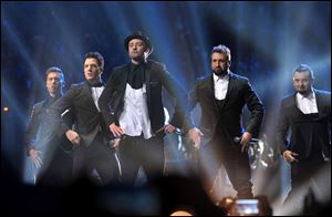 From left, Lance Bass, JC Chasez, Justin Timberlake, Joey Fatone, and Chris Kirkpatrick of 'N Sync perform at the MTV Video Music Awards at Barclays Center on Sunday night in Brooklyn, N.Y.