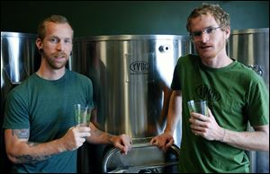 Young Veterans Brewing Co. President Thomas Wilder, left,  and co-founder Neil McCanon spent six years attempting to open their own brewery. The Iraq War veterans will open one next month in Virginia Beach, Va.