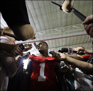 Ohio State Buckeyes running back Dontre Wilson (1) speaks to the media during Ohio State Football media day at the Woody Hayes Athletic Center in Columbus.