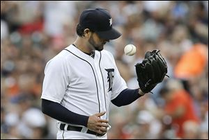 Detroit Tigers pitcher Anibal Sanchez tosses the ball against the Oakland Athletics in the first inning of a baseball game in Detroit, Monday, Aug. 26, 2013. (AP Photo/Paul Sancya)