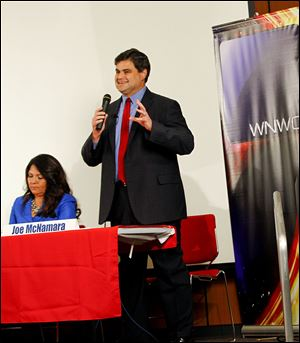 Joe McNamara speaks as Anita Lopez listens during a mayoral candidate forum sponsored by WNWO, Channel 24 at the downtown Toledo-Lucas County Public Library.
