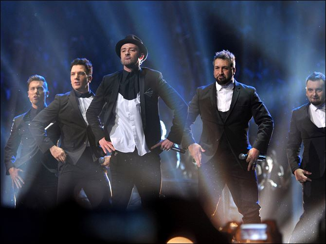 APTOPIX MTV Video Music Awards 2013 Show 8-26 From left, Lance Bass, JC Chasez, Justin Timberlake, Joey Fatone, and Chris Kirkpatrick of 'N Sync perform at the MTV Video Music Awards at Barclays Center on Sunday night in Brooklyn, N.Y.