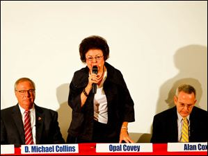 Opal Covey speaks as D. Michael Collins and Alan Cox listen.