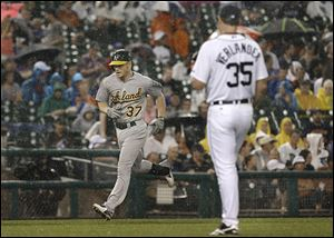 Oakland's Brandon Moss rounds third after he hit a two-run home run against the Tigers' Justin Verlander in the fifth inning.