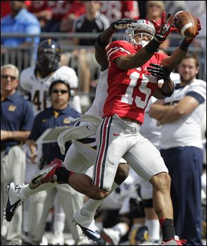 Ohio State's Devin Smith makes a catch against California's Steve Williams. Smith had 30 receptions for 618 yards and six touchdowns last season.