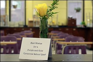 Mr. Yenrick gave a single yellow rose and a welcome card to all of the employees on the first day of school on Tuesday.