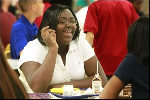 Sophomore Yazmine Reynolds laughs with Lailanai Tompkins at lunch on their first day of school at Waite High School.
