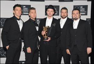 Justin Timberlake, center, winner of the video vanguard award poses backstage with, from left, JC Chasez, Lance Bass, Joey Fatone and Chris Kirkpatrick of 'N Sync  at the MTV Video Music Awards.