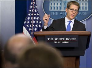 White House press secretary Jay Carney answers questions about Syria and chemical weapons during his daily news briefing at the White House in Washington, Tuesday.