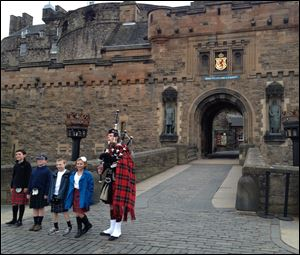 Kids in local garb are 'piped in' before an after-hours tour of Edinburgh Castle.