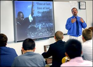 Teacher Chris Stein speaks Wednesday about the impact of Martin Luther King, Jr.'s, 1963 'I Have a Dream' speech in Washington during his comtemporary U.S. history class at St. Francis de Sales High School.