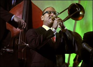 Delfeayo Marsalis performs before 200 enthusiastic people at the Grand Premier Hotel ballroom in Toledo.