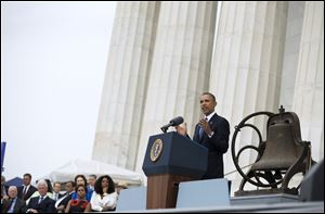 President Barack Obama gestures while speaking during a ceremony commemorating the 50th anniversary of the March on Washington, Wednesday, Aug. 28, 2013, at the Lincoln Memorial in Washington. The president was set to lead civil rights pioneers Wednesday in a ceremony for the 50th anniversary of the March on Washington, where Dr. Martin Luther King's