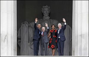 President Obama, former President Jimmy Carter, First Lady Michelle Obama, and former President Bill Clinton acknowledge the crowds as they leave the 50th Anniversary of the March on Washington. Mr. Obama's speech invoked lofty rhetoric while Mr. Carter and Mr. Clinton discussed policy initiatives.