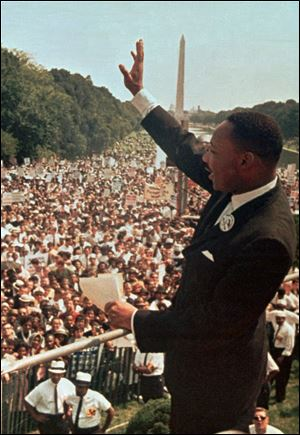 The Rev. Martin Luther King Jr. waves to the crowd at the Lincoln Memorial on Aug. 28, 1963.