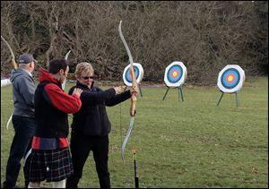 An archery lesson on the grounds of Glamis Castle is among the activities on the Adventures by Disney tour of Scotland.