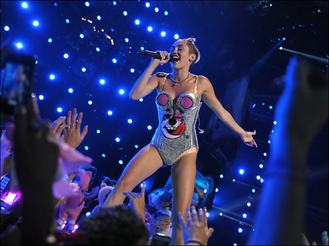 MTV Video Music Awards 2013  Show This image released by MTV shows Miley Cyrus performing at the MTV Video Music Awards.