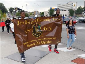 Fraternity members march at the University of Toledo for the anniversary of the March on Washington and also to reflect on the recent trial over the death of Trayvon Martin.