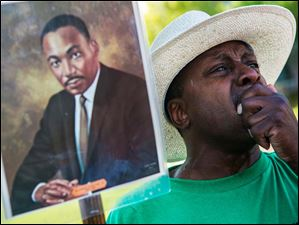 Nathaniel Scott, 49, of Memphis, cries during the commemoration of the 50th anniversary of the March on Washington at the National Civil Rights Museum in Memphis.