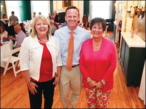 Committee member Annette Sipp, left, emcee Jeff Smith, center, and sponsor Jeanne Eisenhour, right,  during the Bark for Life party at the Carranor Hunt and Polo Club.