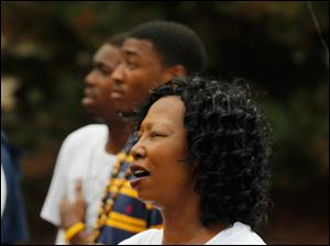 Toledoan Patricia Barry sings the Black National Anthem during a rally at the University of Toledo for the anniversary of the March on Washington and also to reflect on the recent trial over the death of Trayvon Martin.