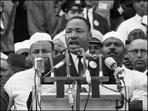 "Dr. Martin Luther King Jr., head of the Southern Christian Leadership Conference, addresses marchers during his ""I Have a Dream"" speech at the Lincoln Memorial in Washington."