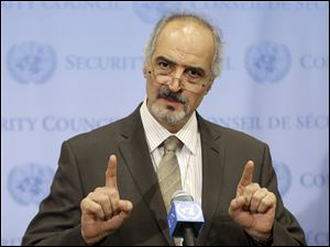 Syrian Ambassador to the United Nations Bashar Ja'afari speaks to reporters.