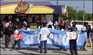 Fast-food protests were under way Thursday in U.S. cities including New York, Chicago and Detroit, seen here. Organizers say they are expecting the biggest national walkouts yet in a demand for higher wages.