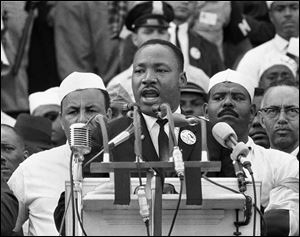 Dr. Martin Luther King Jr., head of the Southern Christian Leadership Conference, addresses marchers during his