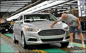Ford began making its Fusion on Thursday at its Flat Rock, Mich., plant. It is the first time the car has been built in the United States.