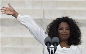 Oprah Winfrey waves as she speaks during the the 50th anniversary of the March on Washington for Jobs and Freedom on Wednesday at the Lincoln Memorial in Washington.