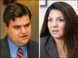 City Councilman Joe McNamara, left, and Lucas County Auditor Anita Lopez, right.