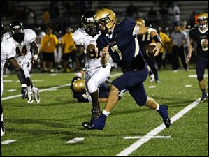 St. John's Jesuit senior quarterback Nolan Silberhorn runs the ball.