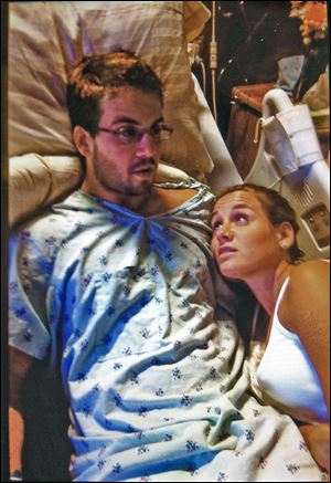 Paul Fudacz, Jr., and his sister Sarah after the bungled transplant surgery at the University of Toledo Medical Center last year.