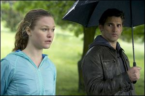Julia Stiles, left, and Eric Bana in a scene from 'Closed Circuit.'