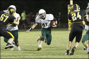 Clay's junior Ryan Fournier gains yardage against Northview. Fournier rushed for 138 yards on 21 carries.