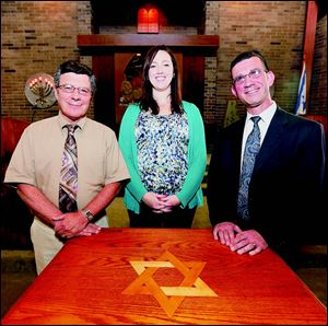 Cantors, from left, Ivor Lichterman, Amanda Winter, and Evan Rubin at Temple Shomer Emunim in Sylvania.