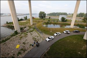 A person is dead today after apparently jumping from the Veterans Glass City Skyway and landing on the banks of the Maumee River in East Toledo. Initial reports are that the person was involved in a chase with Monroe County authorities. Toledo police and Monroe County authorities are on the scene.