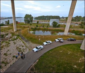 A man is dead today after apparently jumping from the Veterans' Glass City Skyway and landing on the bank of the Maumee River in East Toledo. Initial reports are that the man was involved in a police chase.