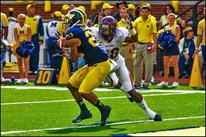 Michigan's Jeremy Gallon catches a touchdown pass against Central Michigan's Dennis Nalor in Saturday's game.