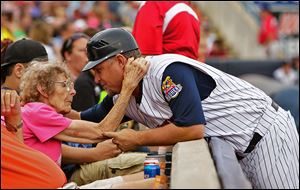 Phil Nevin gets a hug from Toledo Mud Hens' season ticket holder Beulah Remy of Toledo.