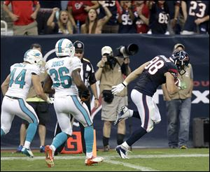 Houston Texans tight end Garrett Graham (88) takes a 33-yard touchdown reception past Miami Dolphins safety Jordan Kovacs (44) and Don Jones (36) in this Aug. 17 photo.