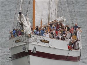 Tourists take a cruise on the tall ship Windy.
