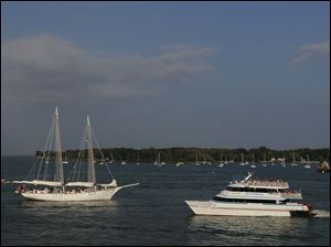 The tall ship Halie & Matthew crosses paths with a Jet Express ferry as it heads back into harbor.
