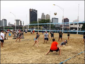 Teams do battle at the AdBASH volleyball tournament at International Park, Thursday, August 8, 2013.