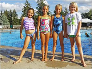 Pictured from left, Jordan Fredrick, 9, Laney Saxe, 9, Zoe Briggs, 9, Maddie Barnesky, 9, during the Kids for Kids pool party fundraiser for the American Cancer Society July 29, 2013 at Highland Meadows Golf Club in Sylvania.